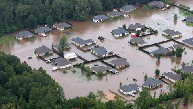 homes surrounded by flood waters